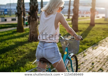 happy young woman riding fixie bicycle at seaside Stock photo © dolgachov