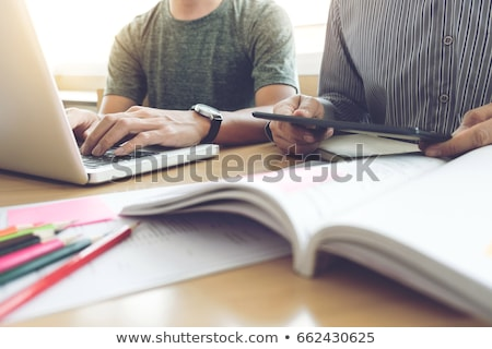 Young students classmates help friend catching up workbook and l Stock photo © snowing