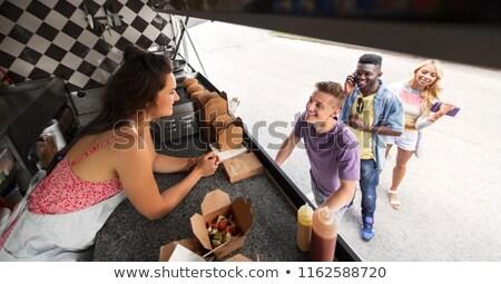 Vásárlók barátok elarusítónő étel teherautó utca Stock fotó © dolgachov