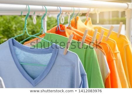 Vestiti rack raccolta bianco colorato illustrazione 3d Foto d'archivio © make