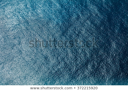 Natural sea background with turquoise water. Top aerial view from drone to moles and jetty with foam Stock photo © artjazz