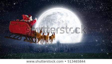karácsony · mikulás · lovaglás · szánkó · égbolt · férfi - stock fotó © colematt
