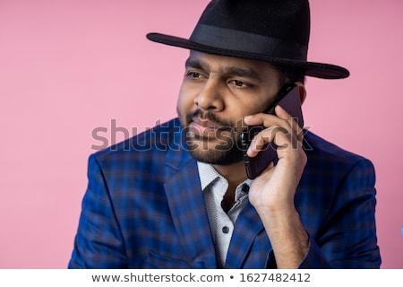 Image closeup of bearded man in formal wear talking on black sma Stock photo © deandrobot