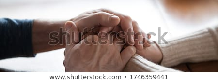 Affectionate and devoted senior spouses holding by hands Stock photo © pressmaster
