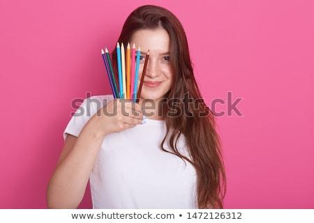 Glücklich jungen Brünette Frau halten Kunstwerk Stock foto © pressmaster