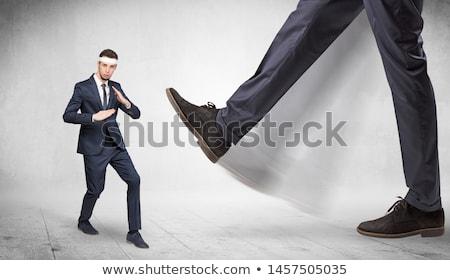 Big foot trample suited karate man Stock photo © ra2studio