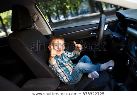 Foto stock: Cute Little Boy Driving Fathers Car
