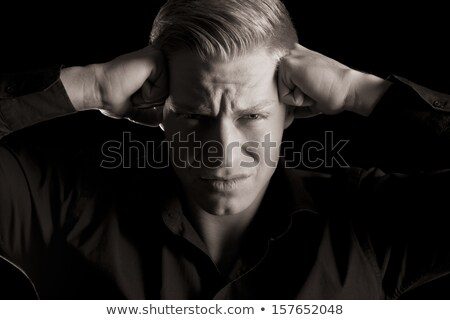 Low key portrait of overburdened young man, black and white. Stock photo © lichtmeister