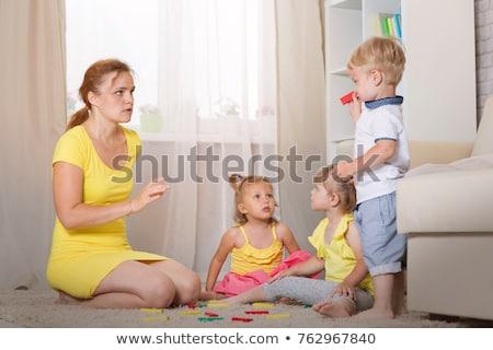 Cheerful mother with her two adorable twin-sons Stock photo © konradbak