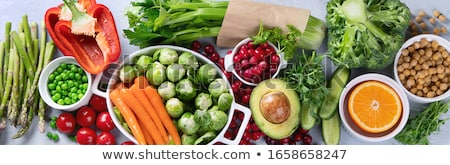 Selection of rich in antioxidants and vitamins and mineral around cutting board. Stock photo © Illia