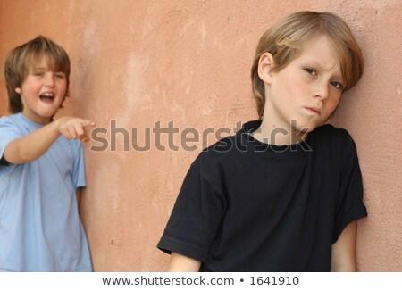 Fiú megfélemlítés másik iskola játszótér diák Stock fotó © Lopolo