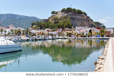 Waterside view to moored yachts at harbour, old famous Denia Cas Stock photo © amok