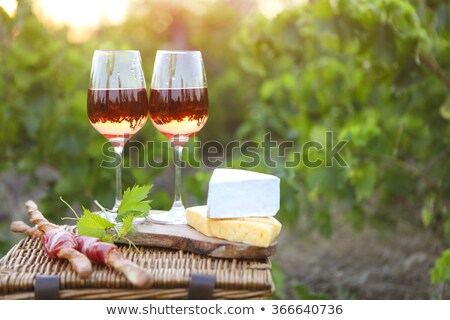 Rose wine bottle and ripe grape Stock photo © karandaev