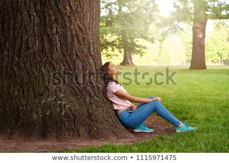 Girl Leaning Against Tree stock photo © cardmaverick2