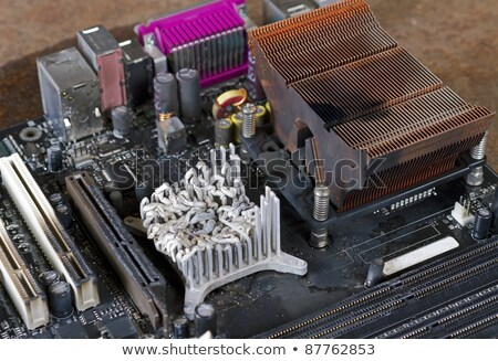 molten cooling element on computer main board stock photo © gewoldi