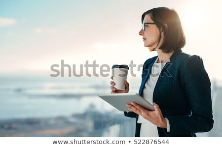 Pense femme d'affaires permanent pensive Photo stock © Maridav