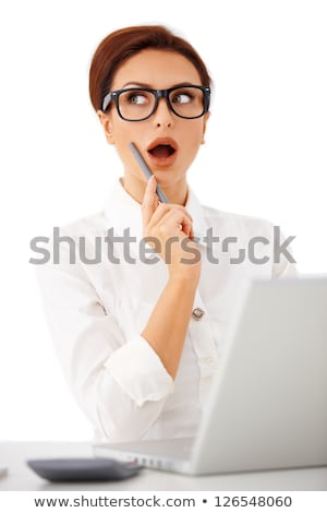 Portrait of a woman with a pen in her mouth Stock photo © photography33