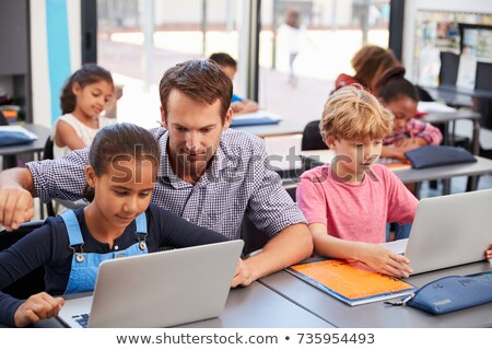 Students using a laptop computer in a classroom Stock photo © photography33