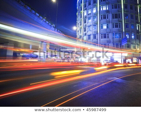 megacity highway at night with light trails stock photo © artphoto
