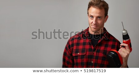 Stock photo: portrait of a man drilling