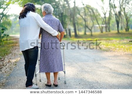 young woman helping senior lady in the garden stock photo © photography33