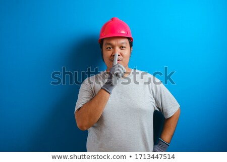 Foreman asking for silence with finger on the mouth Stock photo © photography33