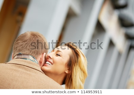 Woman whispering something to her sweetheart Stock photo © stockyimages