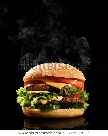 Grande dobrar cheeseburger carne tomates Foto stock © zhekos