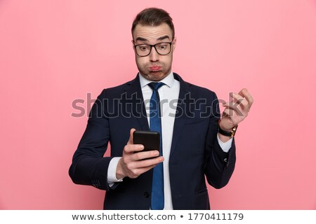 Stock photo: businessman amused at sms