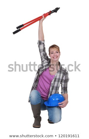 Tradeswoman holding a pair of large clippers in the air Stock photo © photography33