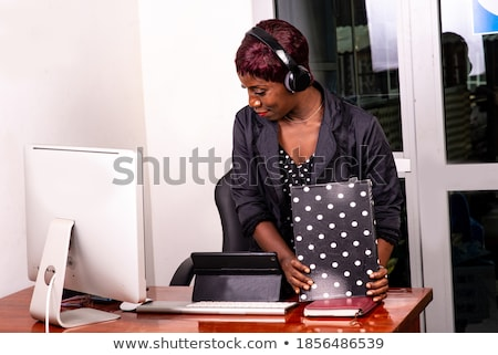 Smiling woman wearing a headset and holding a notebook Stock photo © photography33