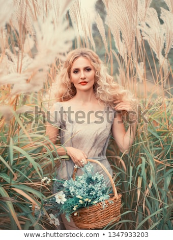 pretty blonde curly girl in witch dress stock photo © carlodapino