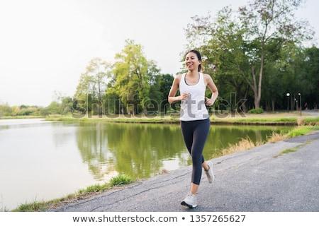 Kobieta jogging chodniku sportu zdrowia buty Zdjęcia stock © bigjohn36