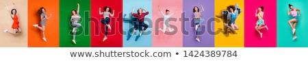 charmant · opgewonden · jonge · vrouw · vieren · overwinning · Blauw - stockfoto © pablocalvog