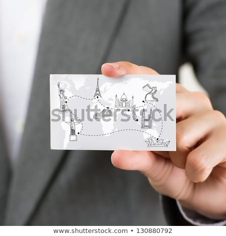 Stock photo: Businesswoman holding business card with world map and famous to