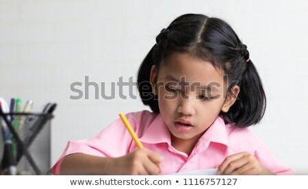 mały · dziewczyna · piśmie · szkoły · biurko - zdjęcia stock © lunamarina