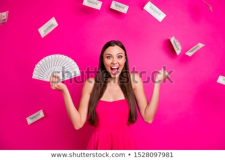 Young long-haired woman throw money Stock photo © maros_b