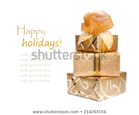 Stockfoto: Beautiful Gift Boxes In Gold Paper With A Silk Rose Isolated On