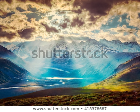 sunbeams coming through the clouds stock photo © sportactive