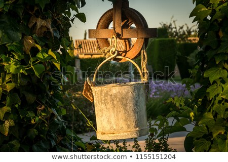 Warm courtyard with well or fountain in Spain Stock photo © backyardproductions