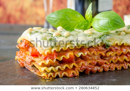 vegetáriánus · lasagne · pirított · fenyőfa · diók · olvad - stock fotó © digifoodstock