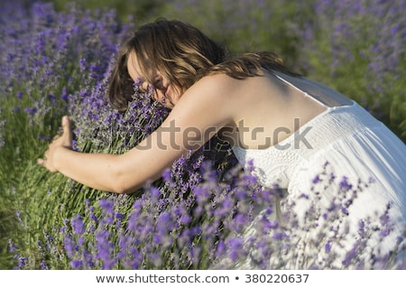 beautiful young woman with purple flowers on head stock photo © svetography
