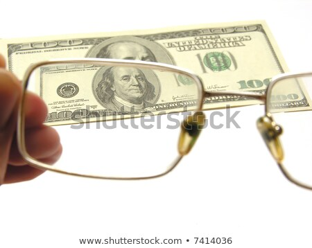 one hundred dollars by the closeup through the eyeglasses on white backgound stock photo © Paha_L