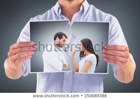 Composite image of angry couple facing off during argument Stock photo © wavebreak_media