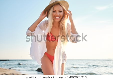 pretty blond girl on beach stock photo © smeagorl