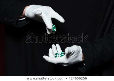 Hands of man magician in white gloves holding casino chips  Stock photo © deandrobot