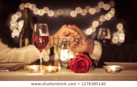Loving young couple enjoy a romantic dinner Stock photo © dash