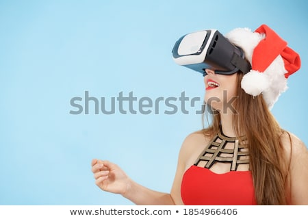 Woman with Christmas Santa Claus hat and VR headset Stock photo © stevanovicigor