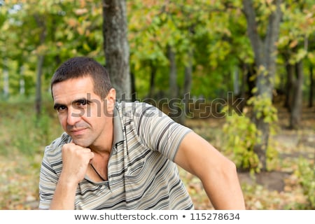distressed middle aged man with hand on forehead stock photo © ozgur