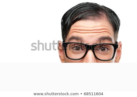 Meglepődött férfi stréber néz mögött szemüveg Stock fotó © deandrobot